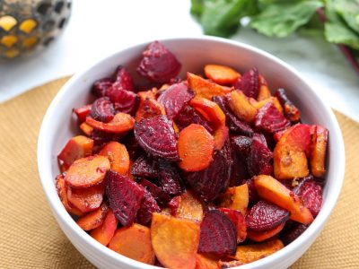close up of a bowl of roasted beets, carrots and sweet potatoes