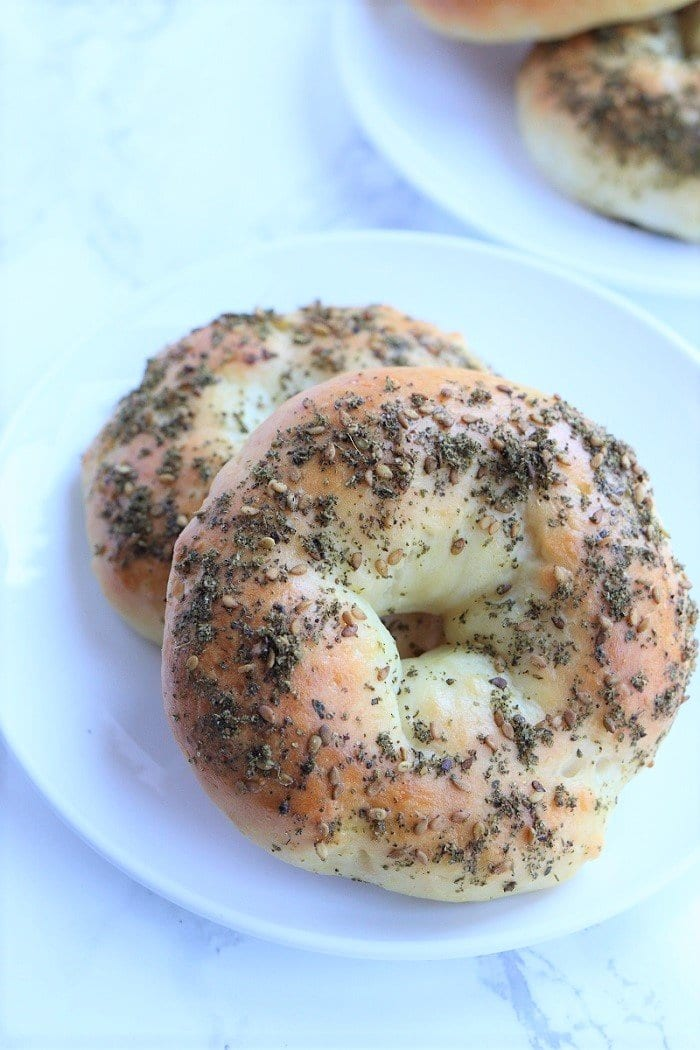 two zaatar bagels on a plate