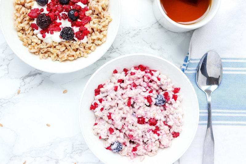 farro breakfast bowl mixed with berries and yogurt