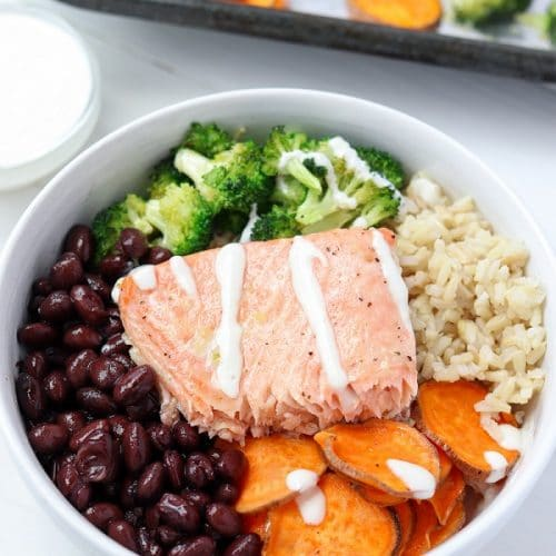 maple glazed salmon buddha bowl drizzled in maple tahini dressing