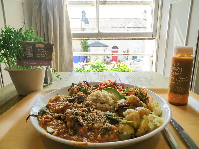 eating a buddha bowl from the happy pear in Ireland