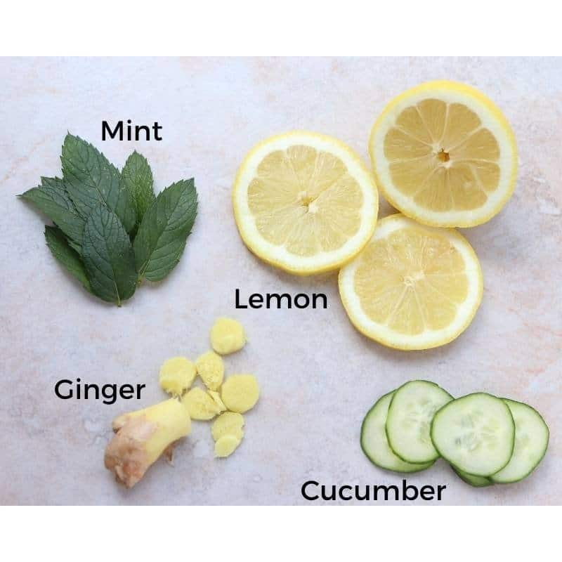 overhead display of mint leaves and sliced ginger, cucumber and lemon