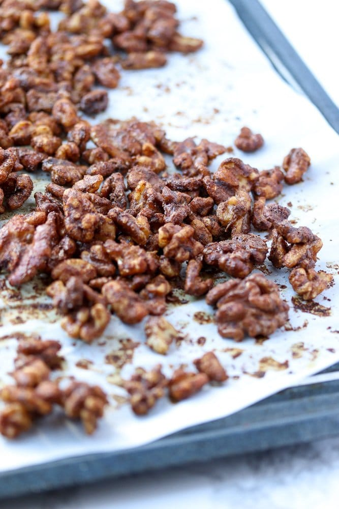 walnuts halves toasted on a baking sheet