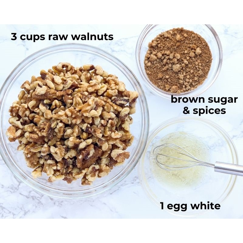 walnuts, brown sugar, spices and an egg white in bowls