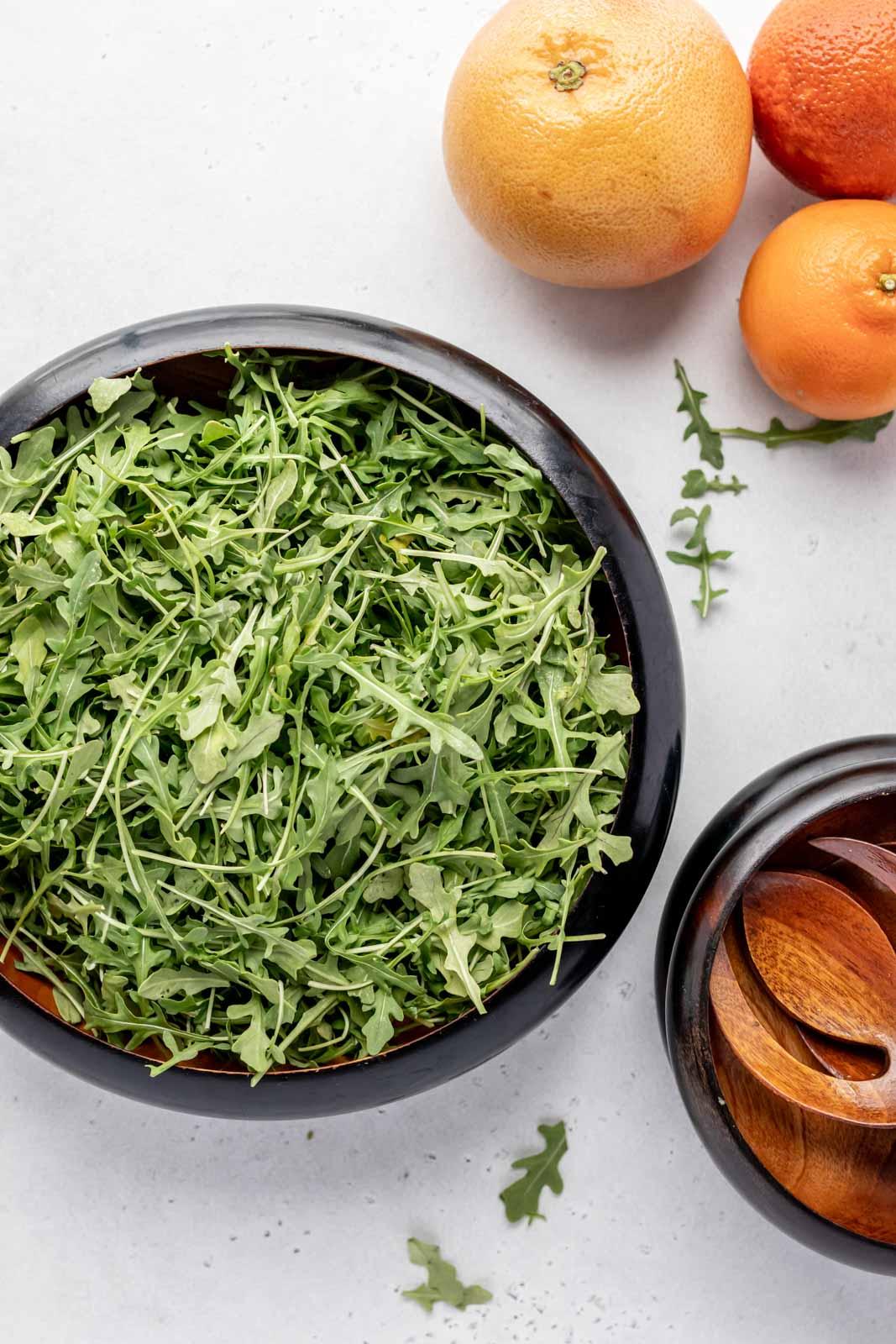 fresh arugula in a large salad bowl