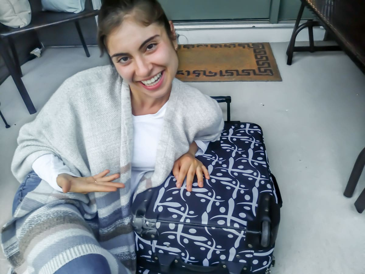 Monica Nedeff leaning on suitcase