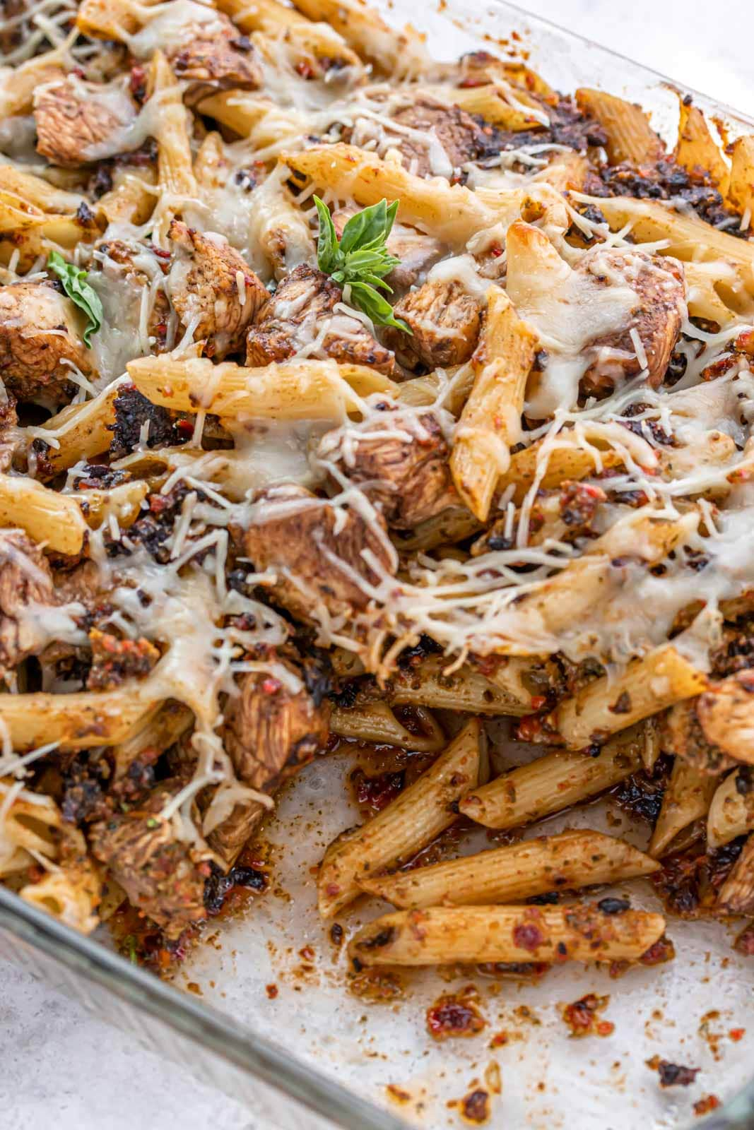 casserole dish of chicken and pasta scooped out