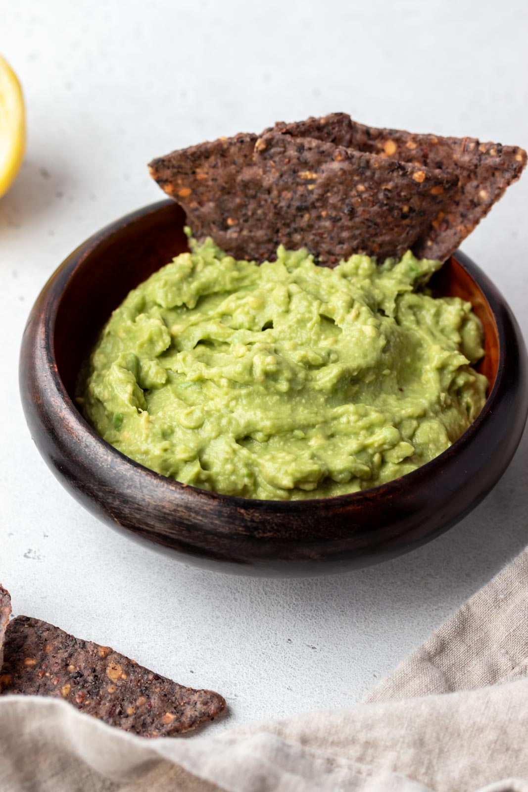 chips sitting in a bowl of guacamole