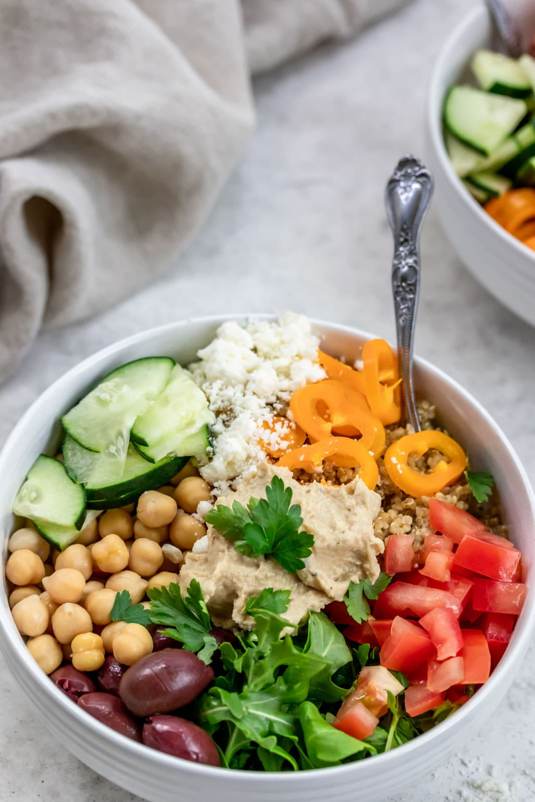 bowl of chickpeas, hummus, quinoa and vegetables