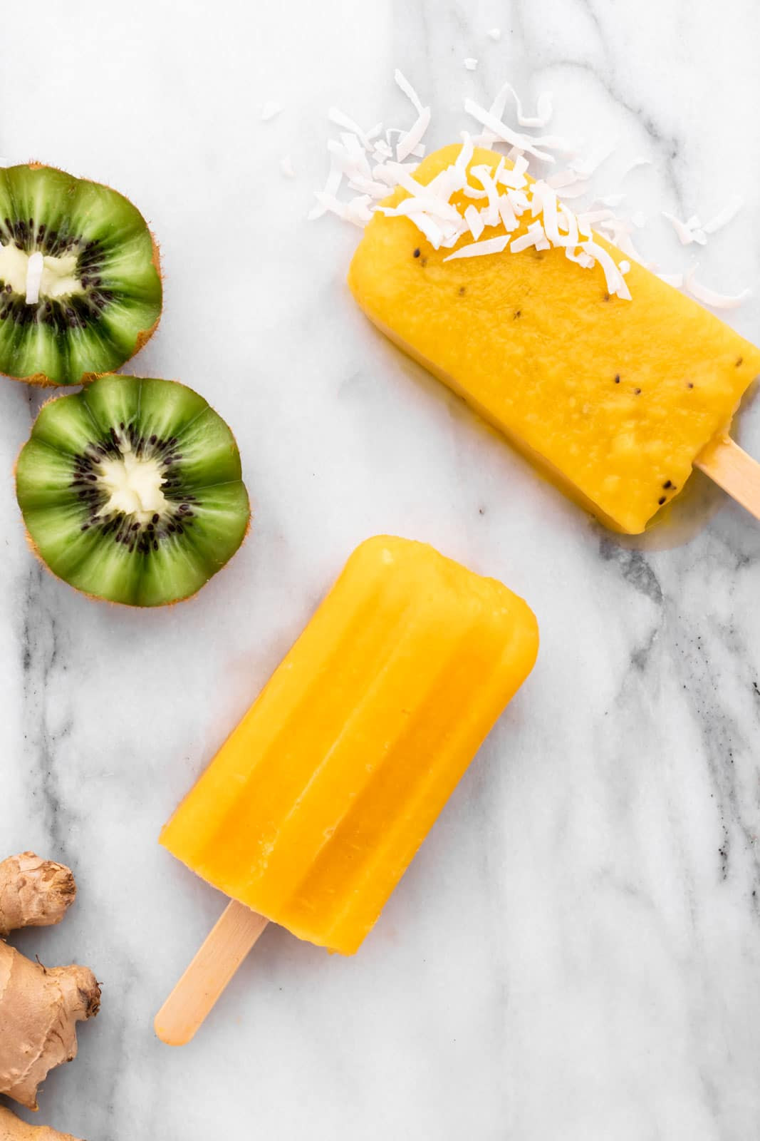 coconut flakes on a mango popsicle