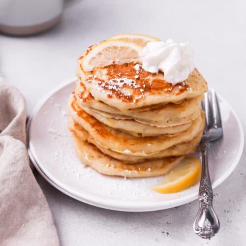 lemon pancakes stacked on plate